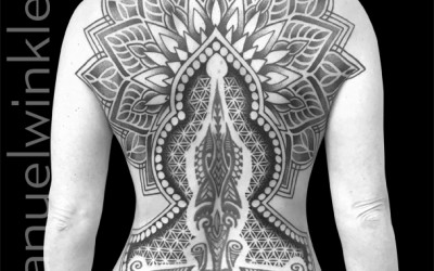 Center on lower back by another artist